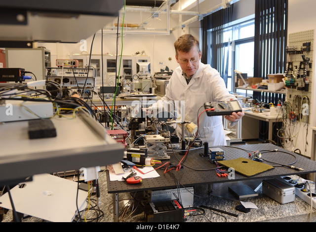 Heinz-Wilhelm Hübers of the Institute of Planetary Research of the German Aerospace Center works in a Terahertz - Stock Image