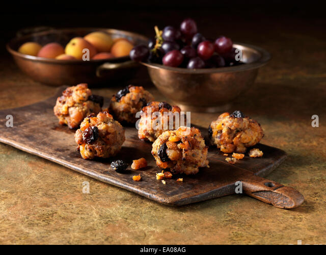 Festive Christmas ingredients of pork, apricot & jumbo flamed raisin stuffing with red grapes and apricots - Stock Image