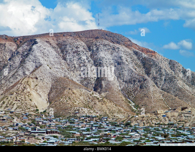 Deforestation and erosion in the hills above Gonaives, Haiti, leaving the town vulnerable to further flooding and - Stock Image