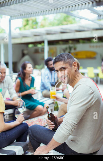 Man smiling at party - Stock Image