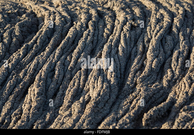 Solidified lava looking like coils of rope - Stock Image
