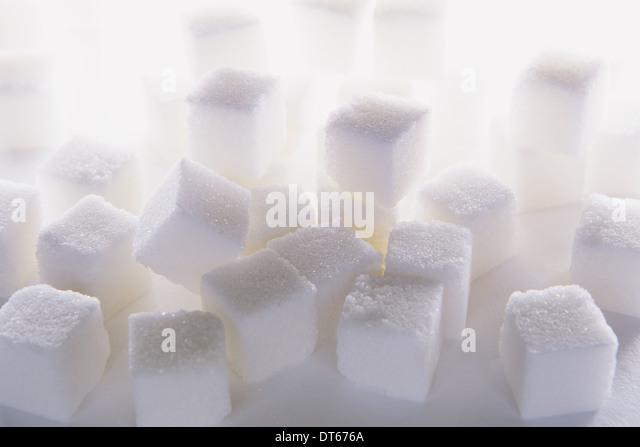 Sugar cubes on white backdrop - Stock Image