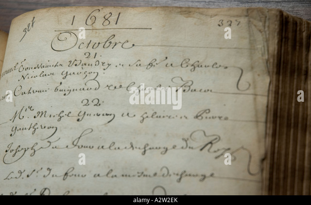 Close-up of old French script in the volume of an ancient notary book, in Paris national archives, France. - Stock Image