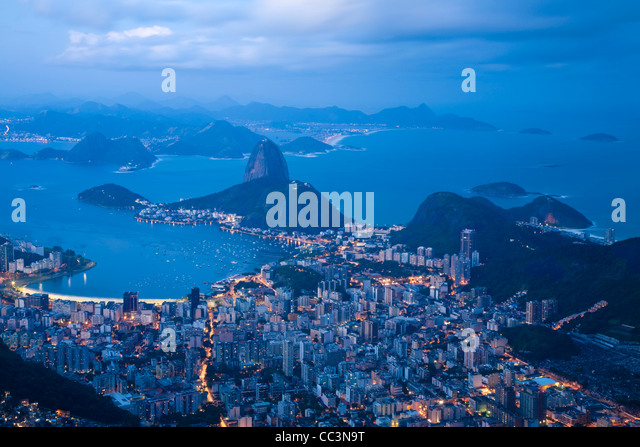 Brazil, Rio De Janeiro, Cosme Velho, View of Sugar Loaf mountain and Botafogo Bay from Cocovado at night - Stock Image