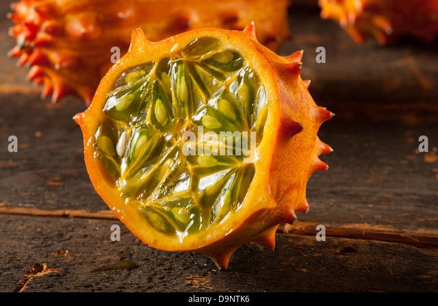 Organic Orange Kiwano Melon with Prickly Spikes - Stock Image