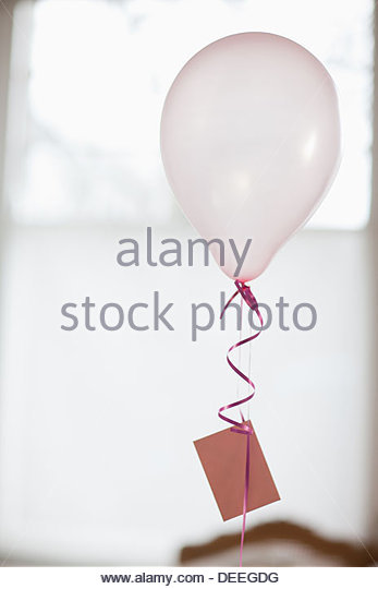 Balloon with card attached to string - Stock-Bilder