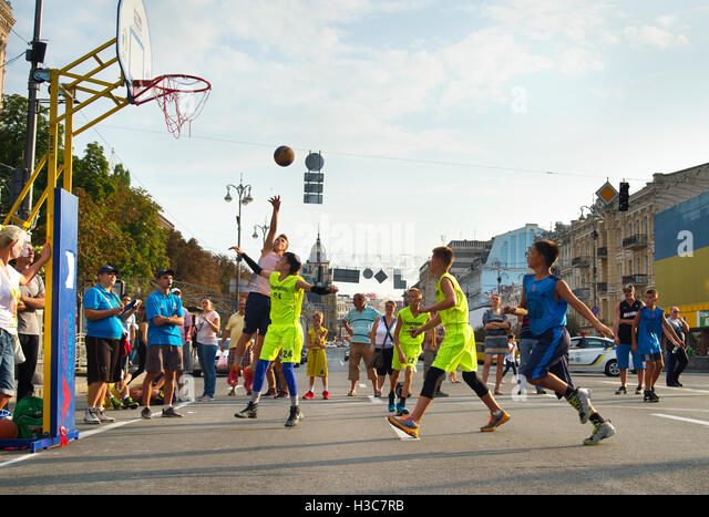 Teenagers playing basketball during the 3x3 Ukrainian Streetball Championship. - Stock Image