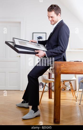 man viewing paintings - Stock-Bilder