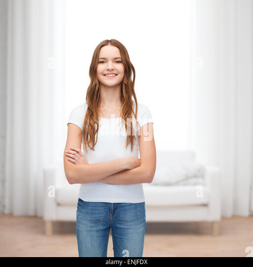 smiling teenager in blank white t-shirt - Stock Image