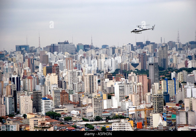 Aerial view of Sao Paulo and a helicopter in flight Brazil - Stock Image
