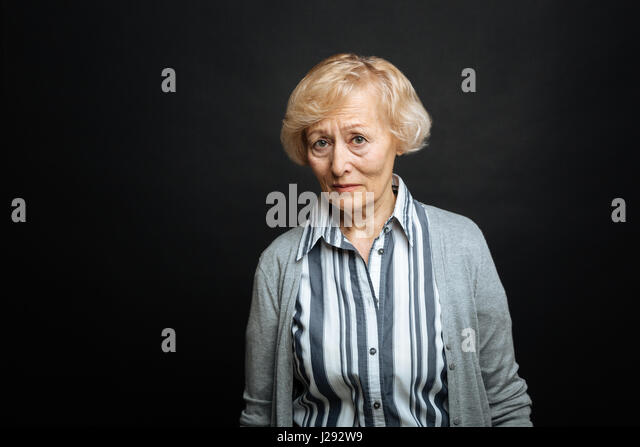 Upset aged pensioner expressing pity indoors - Stock Image