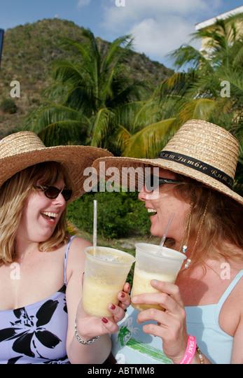 Sint Maarten Philipsburg Dutch White women rum drinks straw hats Point Blanche Mountain - Stock Image