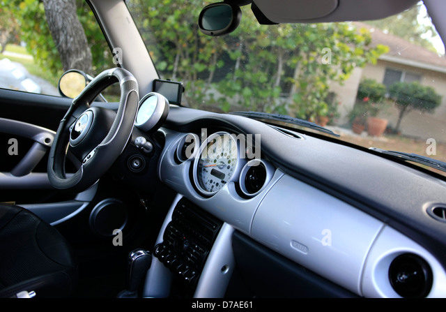The front seats and cockpit of a modern BMW Mini Cooper - Stock Image