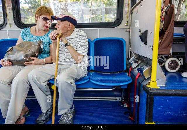 Miami Beach Florida Miami-Dade Metrobus public transportation South Beach Local passengers riders sitting man woman - Stock Image