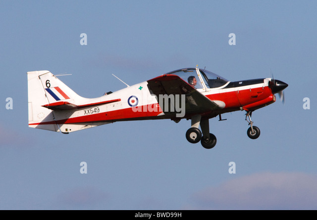 Scottish Aviation Bulldog T1 in the colours of RAF training colours climbing out after take off from RAF Benson - Stock Image