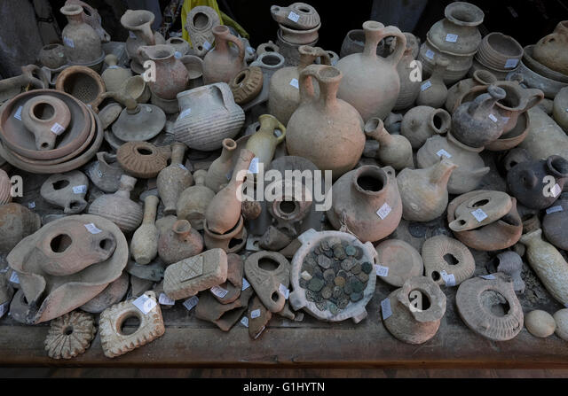 Stack of ancient items at Baidun antiquity shop located on Via Dolorosa Old city East Jerusalem, Israel - Stock-Bilder