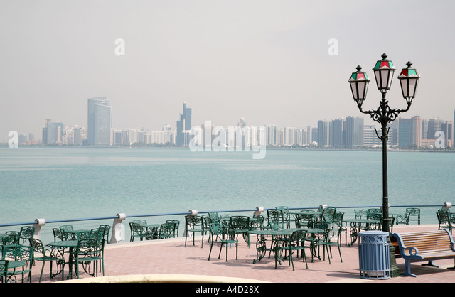 Restaurant in Abu Dhabi city with a backdrop of the gulf and the city skyline, UAE - Stock Image