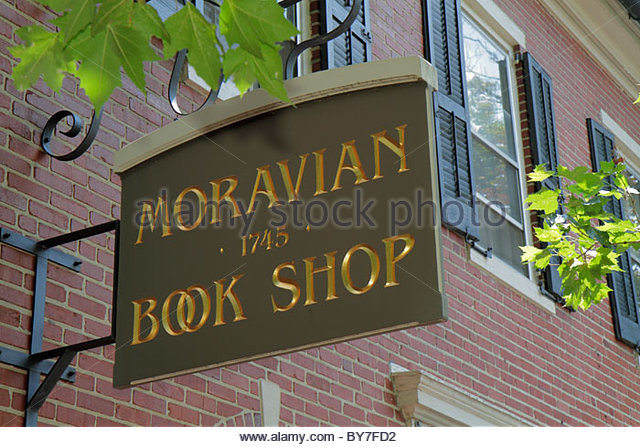 Pennsylvania Bethlehem Main Street historic district Colonial America building 1745 sign Moravian Book Shop store - Stock Image
