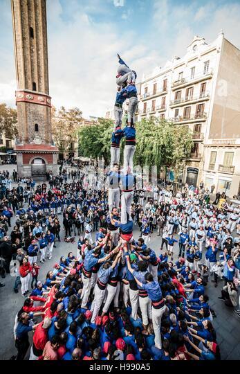 Barcelona, Spain. 20 November, 2016: The 'Castellers de la Vila de Gracia' build one of their human towers - Stock Image