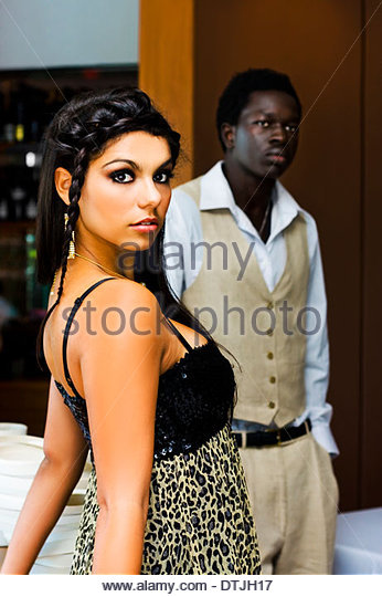 Cute Multicultural Couple On A Evening Dinner Date At A Luxurious Restaurant In A Dating And Romance Conceptual - Stock Image
