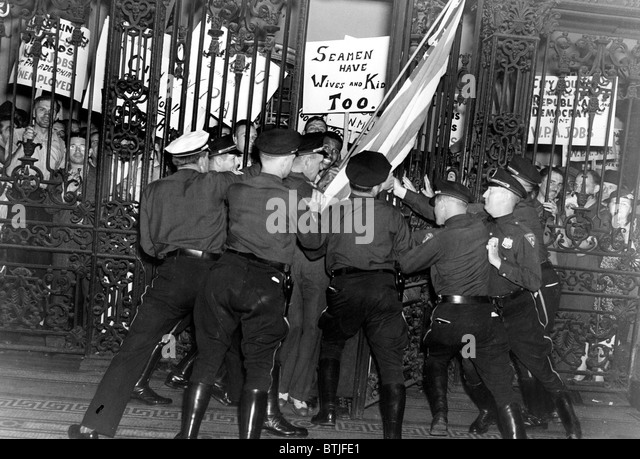 Policemen struggle to hold back more than 1,000 workers who stormed City Hall in Philadelphia, PA, 7/14/38. - Stock Image
