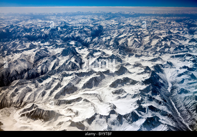 Remote mountains of eastern Himalayas seen from the flight between Lhasa Tibet and Chengdu, Sichuan Province, China. - Stock Image