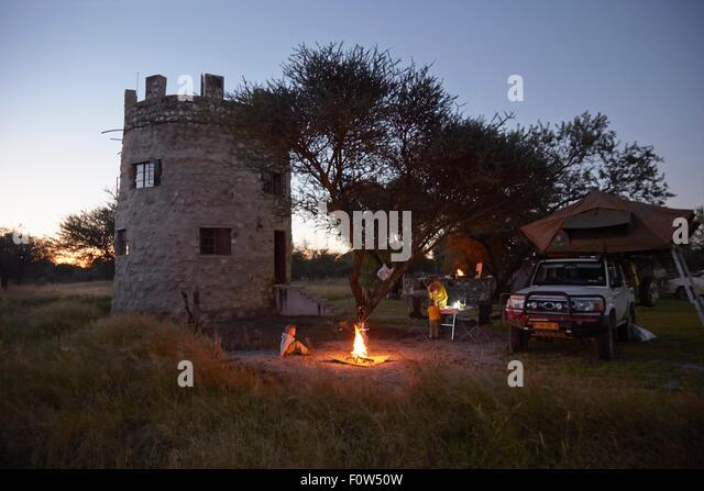 Family around camp fire, Otavi, Etosha, Namibia - Stock Image