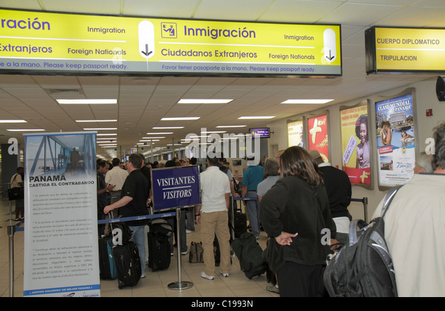 Panama City Panama Aeropuerto Tocumen airport PTY aviation terminal concourse sign man woman international passenger - Stock Image