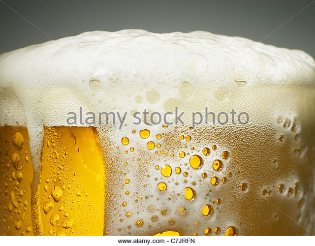 Close up of foaming beer - Stock Image