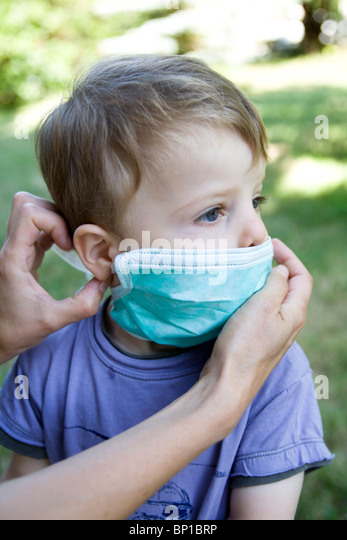 Little boy with protection mask - Stock Image