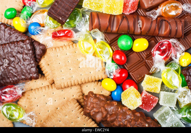 Food concept - candy, chocolate, candy bars, jelly - Stock Image