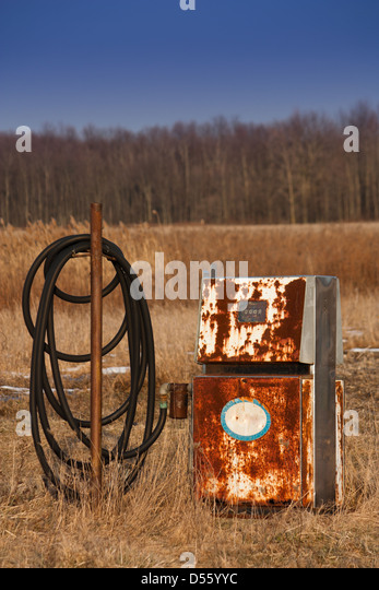 On the Oil Heritage road an old rusty gas pump sits abandoned in a field Could be used to demonstrate new energy - Stock Image