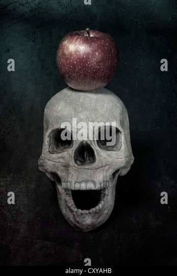a skull and an apple - Stock Image