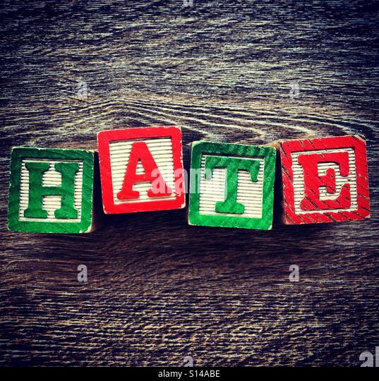 HATE word written with wood block characters - Stock Image