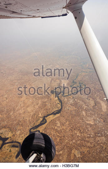 Flying over the land in Botswana, aerial scenic - Stock Image