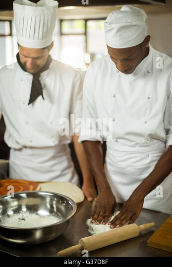 Two chefs making pizza doug - Stock Image