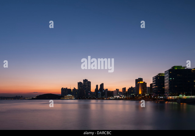 A night view of Haeundae beach skyline in Busan, South Korea seen from Mipo ferry terminal. A long exposure sunset - Stock Image