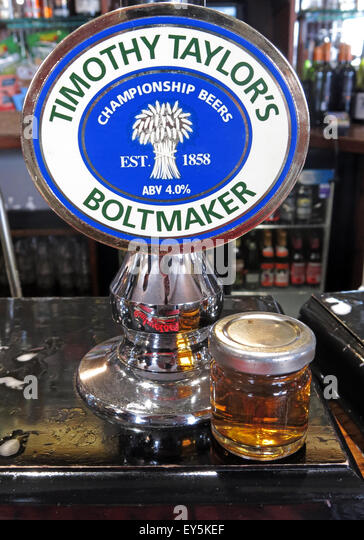 A pump and sample of Timothy Taylor Boltmaker Bitter, in a bar, Yorkshire, England, UK - Stock Image