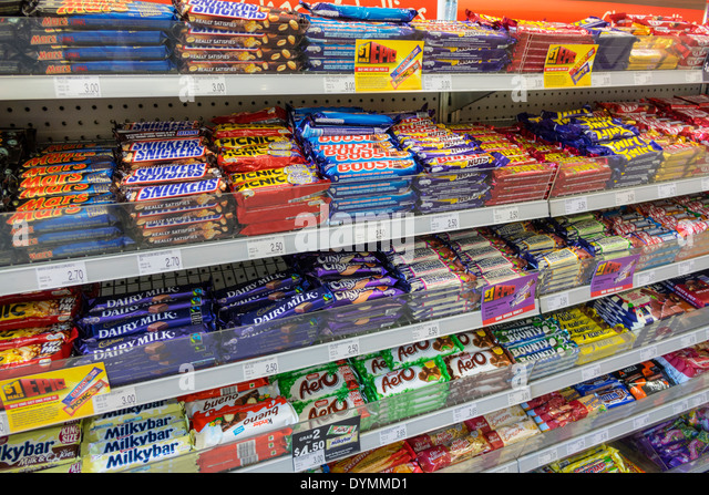 Australia NSW New South Wales Sydney Haymarket Central Station convenience store candy sale retail display competing - Stock Image