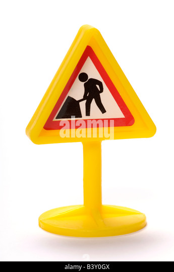 Plastic toy workmen sign - Stock-Bilder