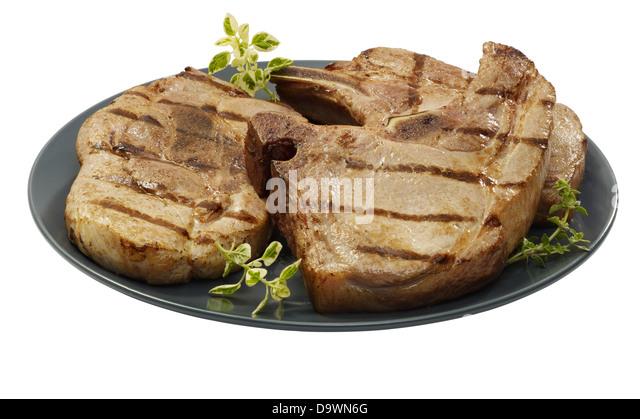 prepared assorted pork chops - Stock Image