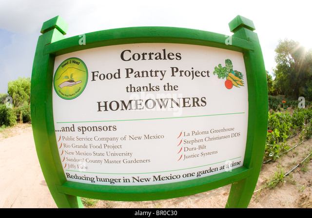 sign in front of Corrales farm food pantry project donation to food bank home produce vegetable donation volunteer - Stock Image