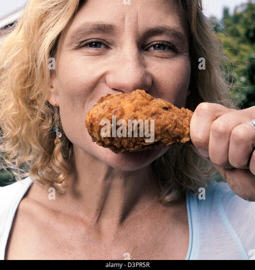 Eating Chicken - Stock Image
