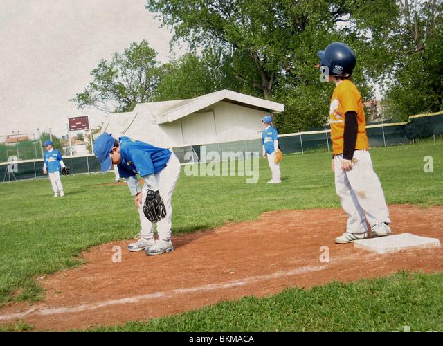boy playing baseball - Stock Image