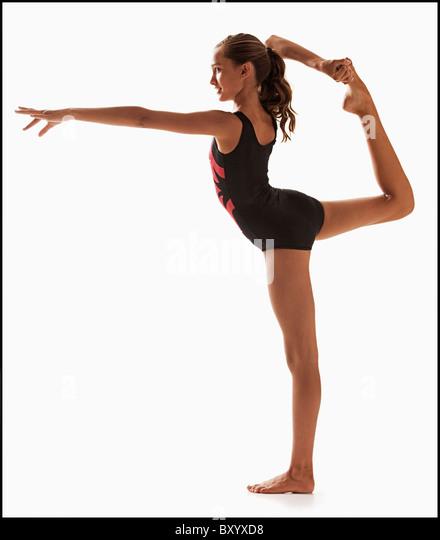 Female gymnast balancing on one leg - Stock Image