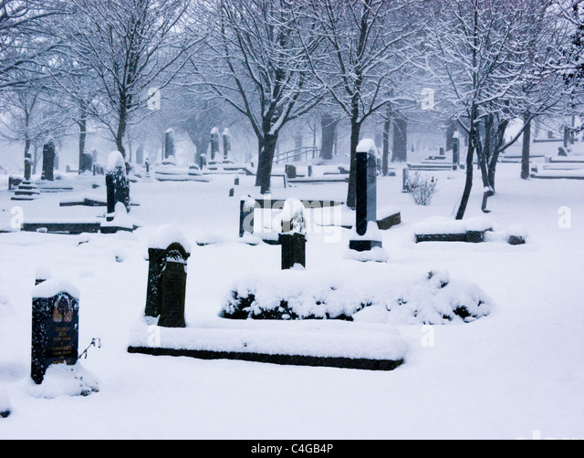 Cemetery during a blizzard - Stock Image