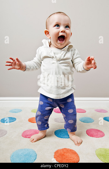 Cute baby Standing - Stock Image
