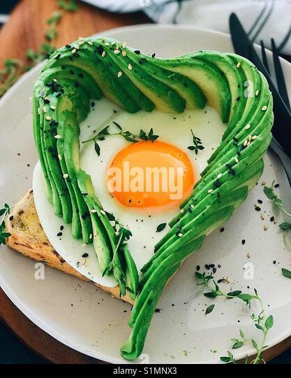Homemade avocado toast with egg - Stock Image