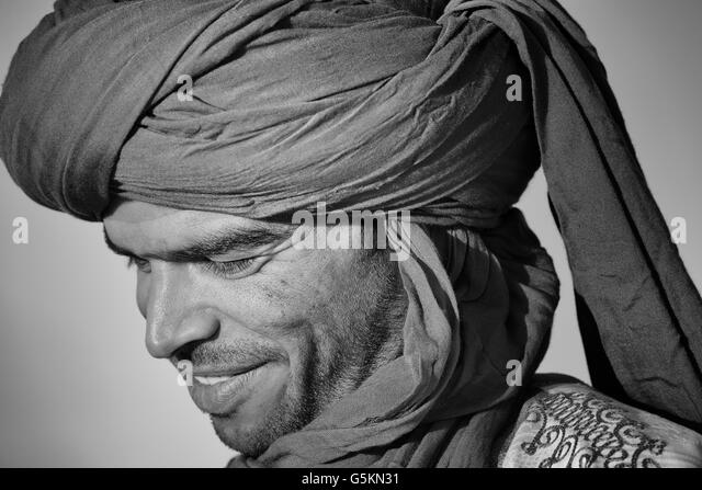 Portrait of a smiling Moroccan man wearing a traditional turban. - Stock Image