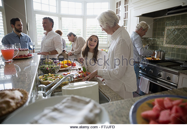 Multi-generation family cooking in kitchen - Stock Image